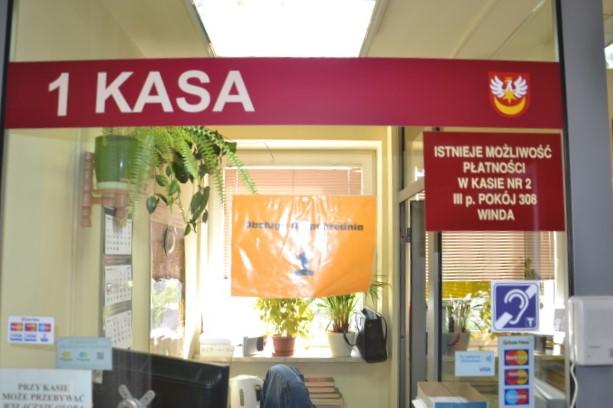 Oznaczenie o pętli indukcyjnej obok Kasy